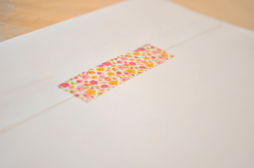 add a special detail to a party invite or card by adding washi tape to a plain white envelope @ thelovenerds