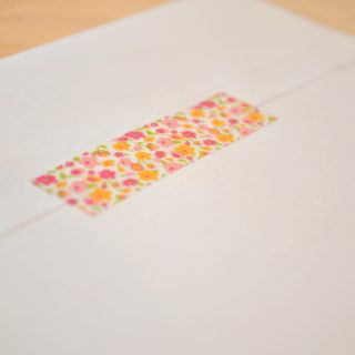 add a special detail to a party invite by adding washi tape to a plain white envelope @ thelovenerds
