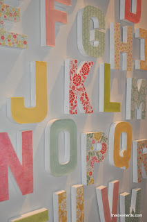 letter wall using paper mache letters, mod podge, and scrapbook paper @ thelovenerds. Perfect for any room (nursery decor, office decor, or family room) just depends on paper choice