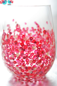 Hand painted stemless wine glasses with red dots using enamel paint and baking in the oven; perfect as a birthday or wedding gift @ thelovenerds