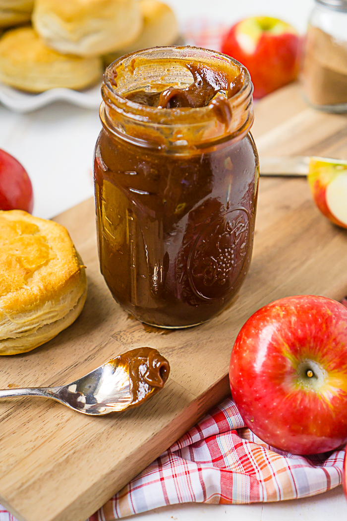Homemade Recipe for Apple Butter in Slow Cooker - Flavorful, spice, and incredibly rich! Inspired by the Cracker Barrel Apple Butter Recipe, this slow cooker apple butter recipe is easy to toss together and easily the best apple butter you've ever tasted! | The Love Nerds #applebutterrecipe #slowcookerapplebutter #crockpotapplebutter
