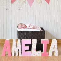 Baby Name spelled out in decorative wooden letters @ The Love Nerds