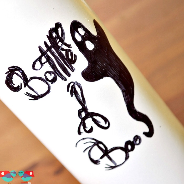 Bottle of Boos - Upcycle a Wine Bottle and create a fabulous creative makeover for Halloween! {The Love Nerds} #Halloween #halloweendecor #winebottle #diy