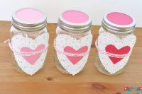 Valentine's Day Decor ideas: Make Ombre Heart Mason Jars with scrapbook paper and doilies! {The Love Nerds} #valentinesday #valentinesdaycrafts #crafts #masonjars #ombre