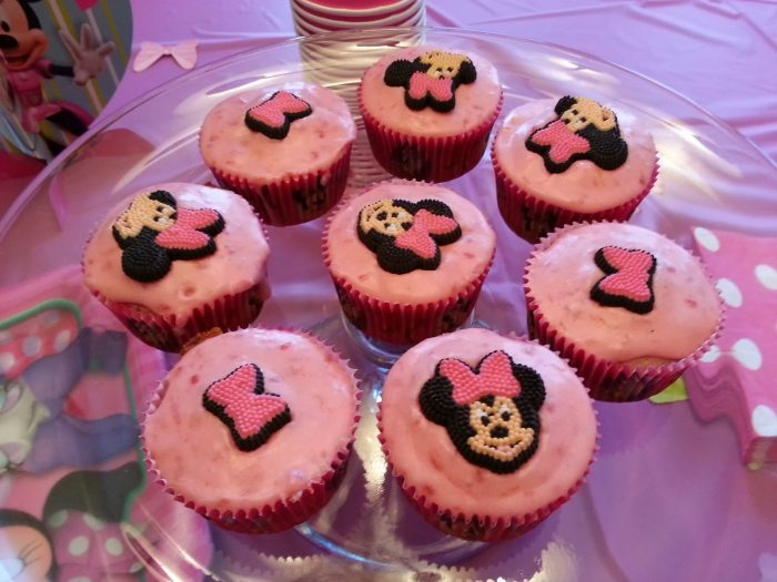 Lemon Raspberry Cupcakes from Home is Where the Heart is - A delicious cupcake flavor with adorable Minnie Mouse cupcake toppers! {The Love Nerds - Birthday Celebrations} #cupcake #recipe #birthdaycake #birthdayparty #minniemouse