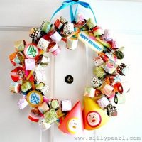 Fantastic Birthday Decoration and Craft - Party Blower Birthday Wreath by The Silly Pearl. Plus, tutorial includes directions for making homemade party blowers! {The Love Nerds - Birthday Celebrations} #birthday #birthdaydecor #birthdaycrafts