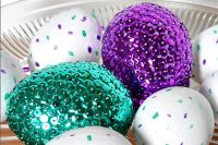 Bright and Colorful Sequined Easter Egg Centerpiece with painted speckled eggs for a finishing touch! {The Love Nerds}
