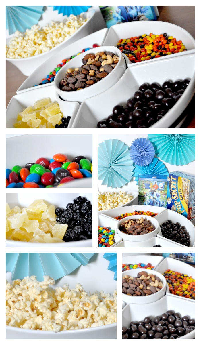 Make your movie night at home special with a fun popcorn bar! Our's was for Rio 2, so we have Blu's favorite blueberries! {The Love Nerds} #PopForRio2 #PMedia #ad