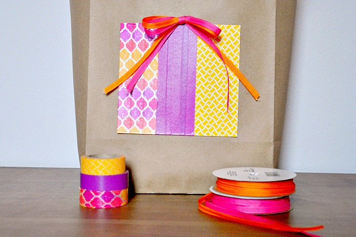 DIY Kraft Gift Bag Idea - Save some money by adding a splash of color to an inexpensive kraft bag! {The Love Nerds} #birthdaygift #giftwrapping #crafts #washitape