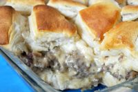 Amazing Biscuits and Gravy Casserole with perfectly fluffy biscuits and delicious sausage gravy. It's a breakfast recipe you will want to make over and over again. {The Love Nerds}