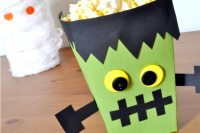 Creating fun Halloween decor and party favor boxes is easy and inexpensive! Come see how I made this fun Frankenstein Monster Popcorn Box and his friend the Mummy! {The Love Nerds}