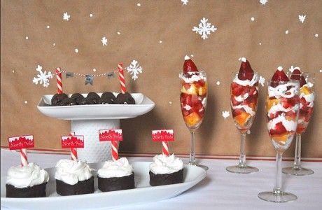Putting together a cute holiday party and a yummy dessert doesn't have to be hard! I put together this party table and treats in only an hour, including these fun Twinkie Strawberry Shortcakes with Santa Hats! {The Love Nerds} #HostessHoliday #ad