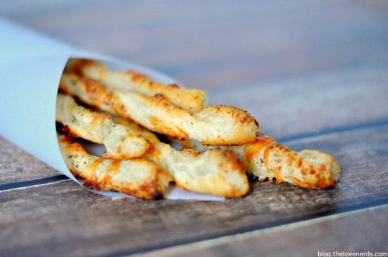 Herbed Cheese Straws is a super easy appetizer, which makes it the perfect date night app! Plus, check out other great recipe ideas for your Dinner for Two! {The Love Nerds}