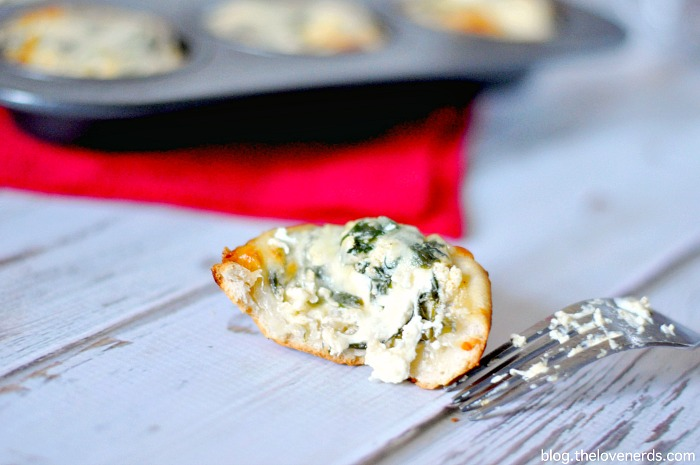 Want to see one of my FAVORITE party foods? Come over for this recipe for Individual Spinach Dip Bread Bowls! They are cheesy, carb heaven! {The Love Nerds}