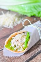 Slow Cooker Chicken Caesar Pitas are the perfect light summer meal - easy to make, not heavy, cooked in a slow cooker and DELICIOUS! Plus, it makes great leftovers!