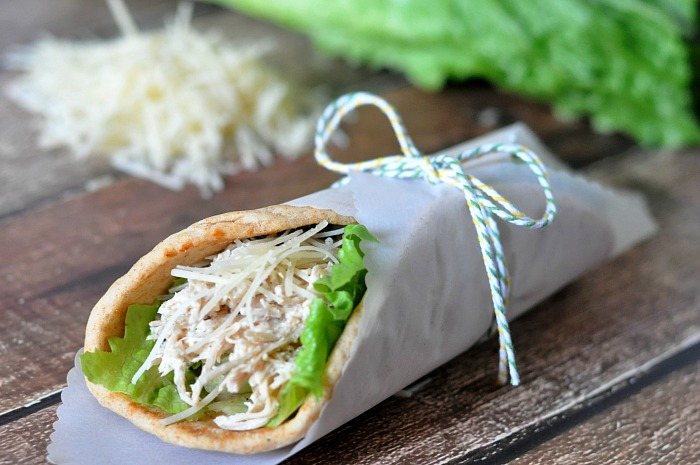 Crock Pot Chicken Caesar Pitas are perfect for summer - easy to make, light, cooked in a slow cooker and DELICIOUS! Plus, it makes great leftovers! |The Love Nerds