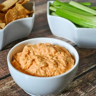 Lightened Buffalo Chicken Dip - healthier ingredients than traditional recipes but still BIG on flavor! It quickly disappeared from the crock pot! |The Love Nerds