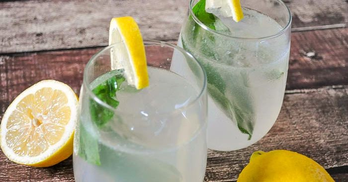 Basil Lemonade Cocktail - A fresh summer cocktail that offers a fun twist on lemonade. Can easily be made as a mocktail for the whole family.   The Love Nerds