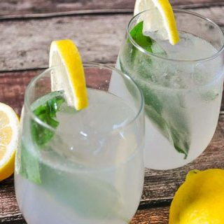Basil Lemonade Cocktail - A fresh summer cocktail that offers a fun twist on lemonade. Can easily be made as a mocktail for the whole family. | The Love Nerds