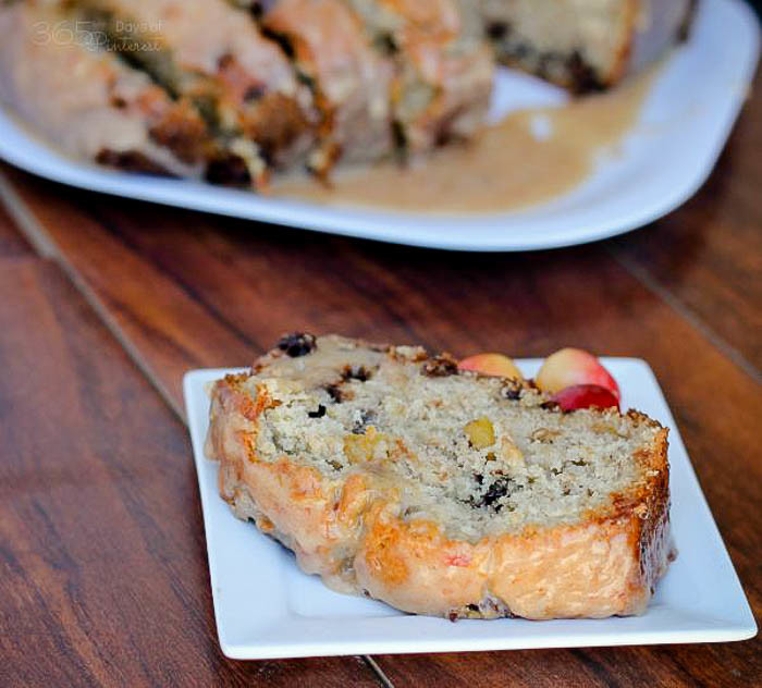 Cherry Banana Bread with Cherry Almond Glaze - Definitely the best banana bread I've ever made. Rustic, moist, sweet and stuffed full of sweet, delicious Rainier cherries. Oh, and chocolate chips! | The Love Nerds Contributors