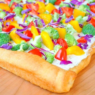 Dill Cream Cheese Veggie Pizza Appetizer - This light, colorful pizza recipe is the perfect summer appetizer! | The Love Nerds #healthyappetizer #flatbreadrecipe #rainbowrecipe
