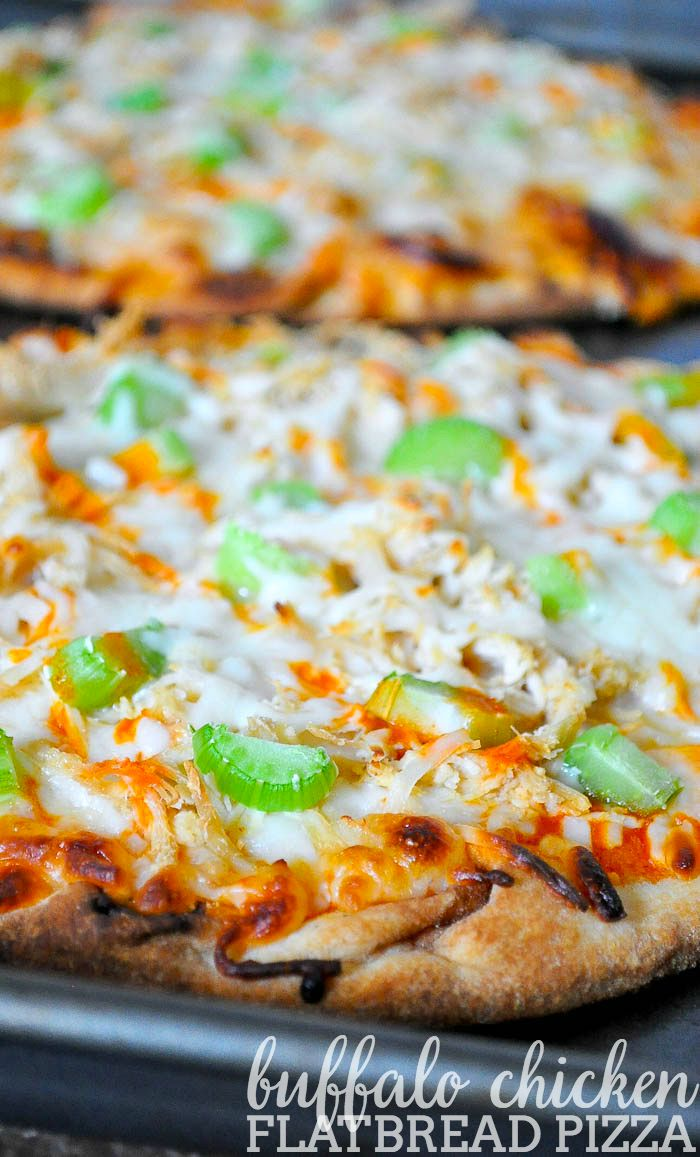 Enjoy delicious Buffalo Chicken Flatbread Pizza in under 20 minutes! Makes a great quick lunch or dinner idea and a crowd-pleasing game day appetizer.   The Love Nerds