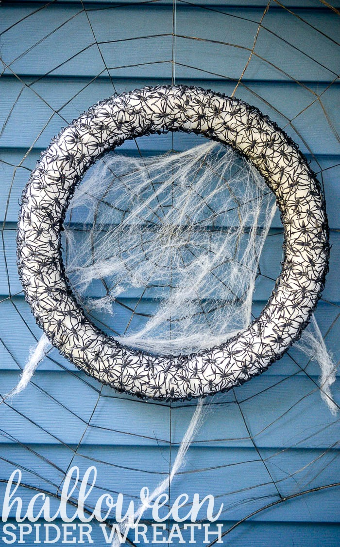 DIY Halloween Craft - This Spider Wreath is the perfect combo of creepy chic as it looks like black lace from afar. If you can hot glue, you can make this craft! | The Love Nerds