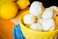 Lemon Coconut Truffles - A refreshing lemon dessert that's perfect for spring and summer! Creamy Lemon inside with a hint of coconut flavor and a white chocolate or vanilla almond coating! | The Love Nerds