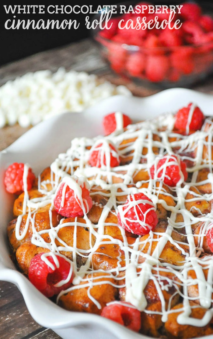 This White Chocolate Raspberry Cinnamon Roll Casserole will impress all of your guests but only take you 15 minutes of prep time! | The Love Nerds #ad #FestiveFlavors @InDelight