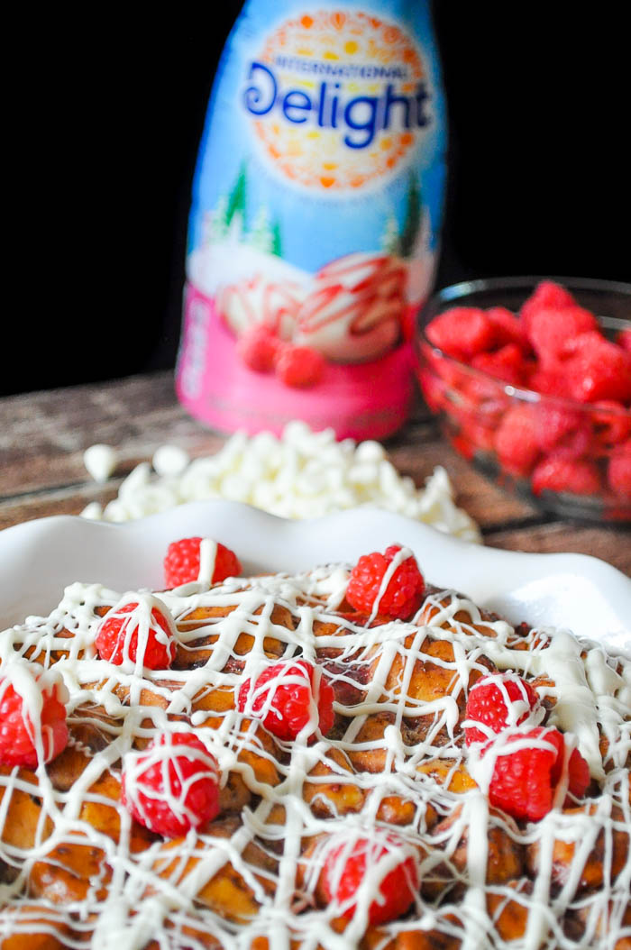 This White Chocolate Raspberry Cinnamon Roll Casserole will impress all of your guests but only take you 15 minutes of prep time! | The Love Nerds #ad #FestiveFlavors