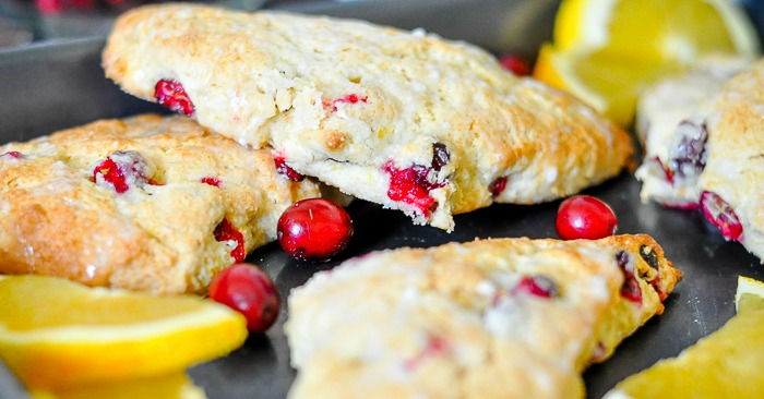 Cranberry Orange Scones make a delicious holiday brunch recipe! The sweet and tart flavors from the fresh cranberries and oranges combine perfectly with the (optional) creamy egg nog for a special Christmas brunch treat in this easy scone recipe! | The Love Nerds
