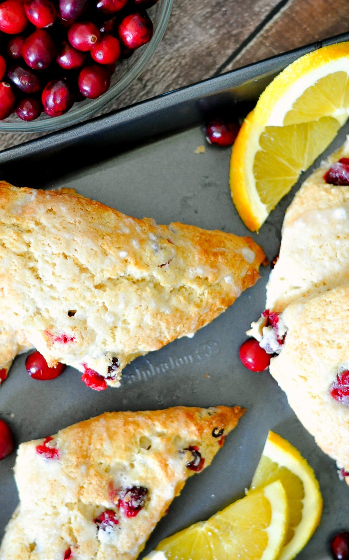 Cranberry and Orange Egg Nog Scones make a delicious holiday brunch recipe! The fresh citrus flavors combine perfectly with the creamy egg nog.   The Love Nerds #ad @InDelight