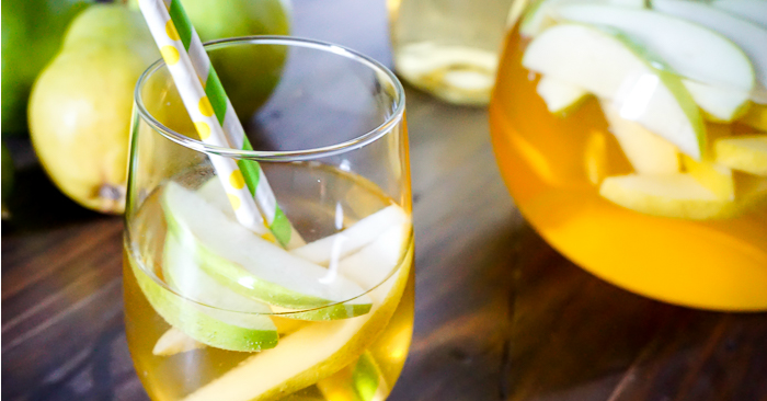 Green Apple and Pear Sangria Recipe - A delicious wine recipe that everyone will love with the perfect combination of sweet and tangy. | The Love Nerds #ad