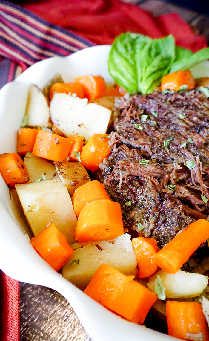 Slow Cooker Pot Roast - A savory and hearty crock pot recipe that is perfect for a cold winter night! | The Love Nerds