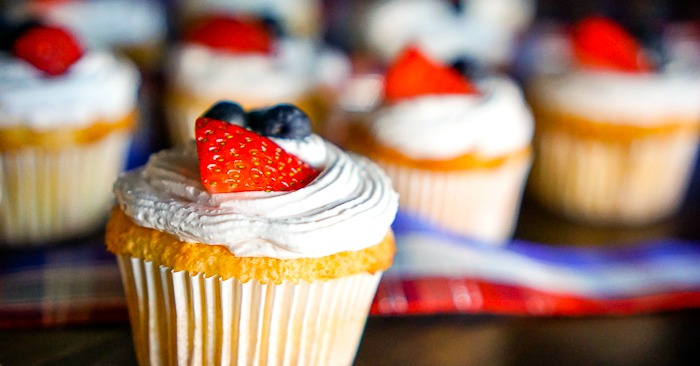 Angel Food Cake Cupcakes with Strawberry Whipped Topping - A light and airy summer dessert recipe that everyone will love! Plus with Red, White, and Blue, it makes a perfect 4th of July dessert! | The Love Nerds