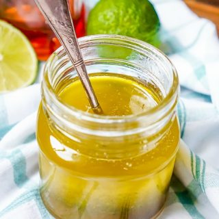 Honey Lime Vinaigrette - A light salad dressing recipe that will bring a delicious sweet & tangy touch to your salads! | The Love Nerds