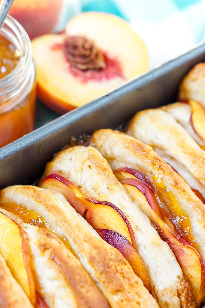 Peach Pull Apart Bread - Sweet and juicy pull apart bread recipe that can be enjoyed for dessert and even breakfast! | The Love Nerds