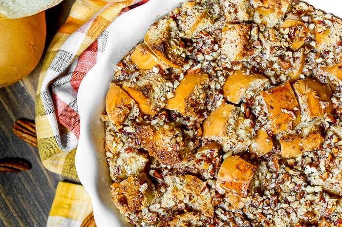Pecan Pie French Toast Bake is warm, nutty, and holiday perfection! This brunch recipe will make you happy with every single bite! | The Love Nerds