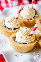 Peppermint Hot Chocolate Cookie Cups are a bite of holiday perfection! Serve up these adorable Christmas Cookies at your next holiday party. | The Love Nerds