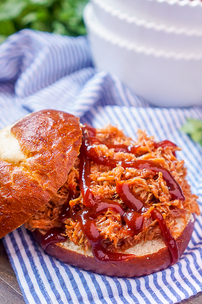4 Ingredient Slow Cooker Pulled Pork Recipe - One of our incredibly easy family dinner recipes that is perfect for serving large groups or as leftovers! | The Love Nerds