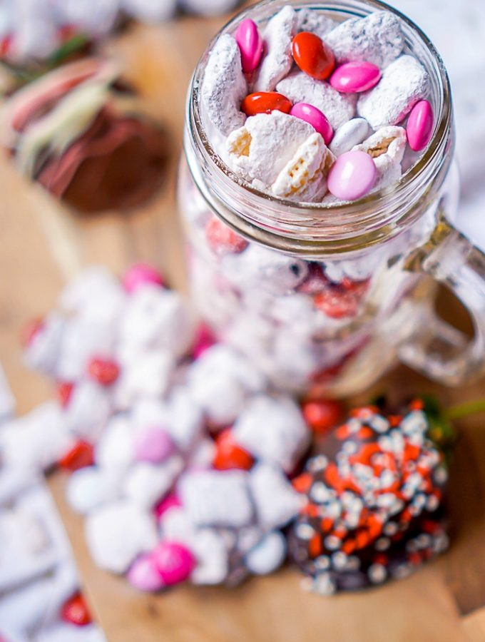 Chocolate Covered Strawberry Puppy Chow - Improve your Muddy Buddies game with the perfect Chocolate and Fruit Combo! It makes a great Valentine's Day Treat but it's a tasty and easy dessert all year long! | The Love Nerds