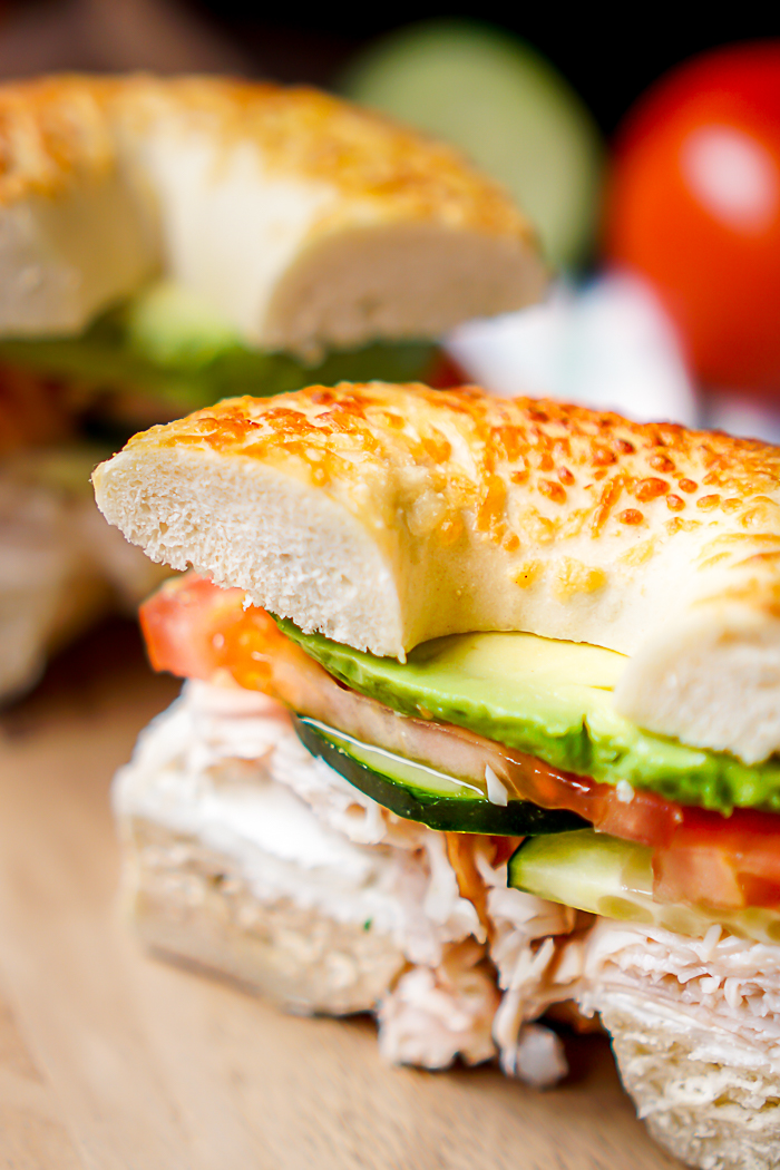 veggie and cream cheese turkey bagel sandwich