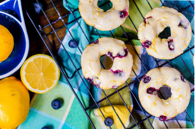 Baked Lemon Blueberry Donuts Recipe - Sweet and tangy flavors combine for the perfect baked donut! Make this breakfast recipe for your next holiday or brunch! | The Love Nerds AD BobsSpringBaking @BobsRedMill