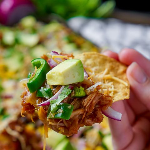 BBQ Pulled Pork Nachos - A tasty dinner or game day appetizer that only takes 15 minutes to make! Baked Nachos are always a quick and fun addition when menu planning! | The Love Nerds