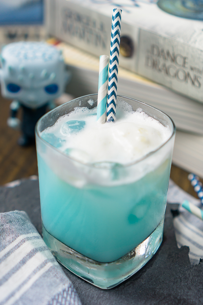 Game of Thrones Ice Dragon Cocktail Recipe - This Game of Thrones Recipe honoring the Ice Dragon and Night King is the perfect cocktail recipe for calming any nerves that comes with the show!   The Love Nerds #gameofthrones #gameofthronesrecipe #cocktailrecipe #bluecocktail