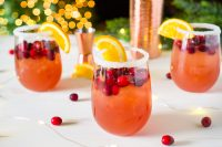 The Orange Cranberry Margarita is an easy holiday cocktail recipe for Thanksgiving and Christmas! The sweetness of the orange complements the tartness of the cranberries, making it a big crowd pleaser. Plus, sipping a holiday drink garnished with fresh cranberries and orange slices is festive and fun! | The Love Nerds #cranberryorange #holidaycocktail #christmasmargarita