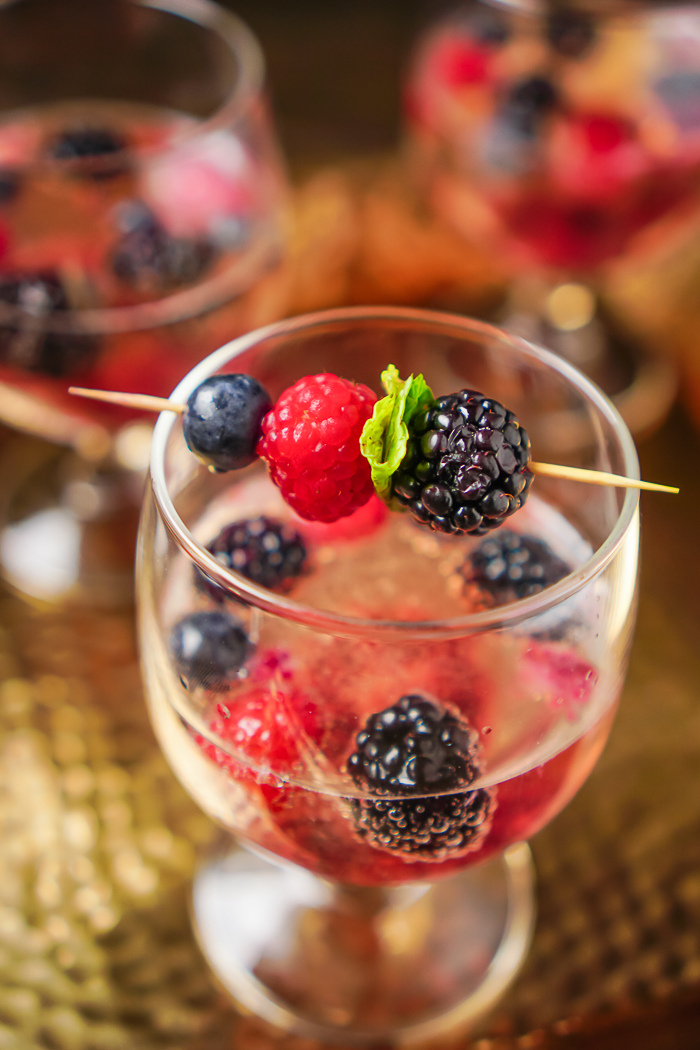 Berry Champagne Cocktail Recipe is a gorgeous holiday cocktail for Christmas or New Year's Eve as well as the perfect anniversary cocktail recipe! It's a fruity sparkling drink that's pretty enough for any special occasion.