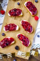 Crostini appetizers make party menus simple while still being big on flavor, and these Goat Cheese Crostinis with a homemade berry jam is the best crostini appetizer! Sweet, Tangy and Gorgeous!