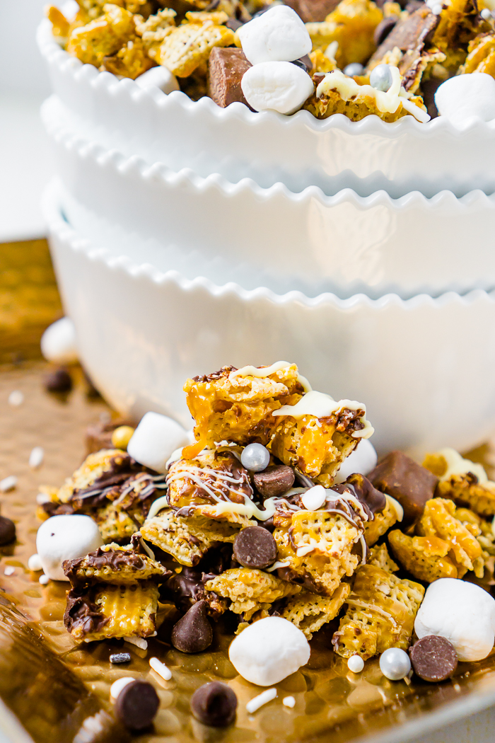 Double Chocolate Caramel Snack Mix is an easy sweet chex party mix with caramel, chocolate, white chocolate, snickers bites, mini marshmallows and gold and silver sprinkles. Perfect party dessert for a big birthday or New Year's Eve!