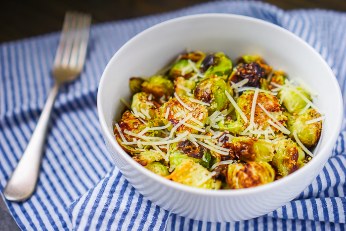 Garlic Parmesan Brussels Sprouts are cooked in the oven for an easy Christmas Side Dish or Thanksgiving Side Dish.